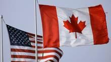 Canadian and U.S. flags. (David Duprey/AP)