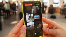 "Both the 920 and 820 will be available in several colours, including bright yellow and ""lipstick red."" While some might say a yellow phone is gaudy, it's an idea whose time may have come. After trying it out, I felt like I was holding a little Lamborghini in my hand. (Peter Nowak For the Globe and Mail)"