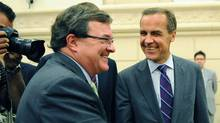 Finance Minister Jim Flaherty and Bank of Canada Governor Mark Carney cross paths as they appear before a Commons committee in Ottawa on Aug. 19, 2011. (Sean Kilpatrick/THE CANADIAN PRESS)