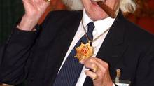For decades, James Savile was a fixture on British TV as an eccentric, jocular host of children's shows. Since he died, several women have come forward to claim he was a serial abuser of underage girls. (Lewis Whyld)