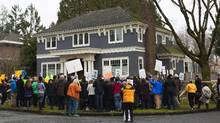People gather on Sunday to protest the upcoming demolition of a 20-year-old house on Adera Street in Vancouver. (Rafal Gerszak For the Globe and Mail)
