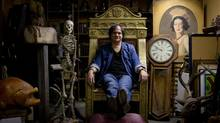 Jim Buckshon, president of the Renegade Arts Society, poses for a photograph with some of the props he saved from the Vancouver Playhouse Theatre Company that closed down in 2012. (DARRYL DYCK)