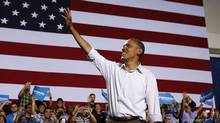 U.S. President Barack Obama waves at a campaign event at the Kissimmee Civic Center in Florida, September 8, 2012. (LARRY DOWNING/REUTERS)