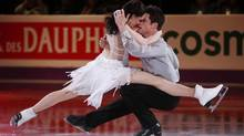 Tessa Virtue and Scott Moir say they feel the pressure now that they are defending champions. (MARK BLINCH/REUTERS)