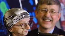 Dr. Francis Collins, right, author of a study suggesting the protein that causes accelerated aging in children also has a role in normal aging. He is seen with 15-year-old John Tacket in 2003. (AP)