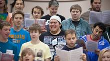 Nineteen-year-old Jason Diodati (wearing baseball cap) performs during a rehearsal with the Youth Singers of Calgary, a performing arts opportunity for young people based in Calgary, Alberta. (Chris Bolin for The Globe and Mail/Chris Bolin for The Globe and Mail)
