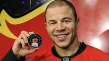 Calgary Flames' Jarome Iginla poses with his 500th goal puck after the Flames' defeated the Minnesota Wild in their NHL hockey game in Calgary, Alberta January 7, 2012. REUTERS/Todd Korol (Todd Korol/Reuters)