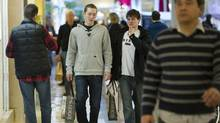 Last minute Christmas shoppers crowd Sherway Gardens shopping mall in Toronto in December, 2011. (Kevin Van Paassen/The Globe and Mail/Kevin Van Paassen/The Globe and Mail)