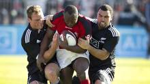 The strength exhibited by Canadian Nanyak Dala, centre, surrounded by New Zealand Maori All Blacks defenders, isn't gained easily or quickly in the gym. (Peter Power/The Globe and Mail)