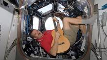 Somewhere on the spacetime continuum, astronaut Chris Hadfield must be doing some good for the world – without any Twitter followers. (NASA/REUTERS)