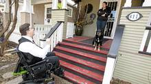 Alberta Liberal candidate Kent Hehr talks to voter Jan Pugh on the steps of her Calgary home. (Chris Bolin/Chris Bolin for The Globe and Mail)
