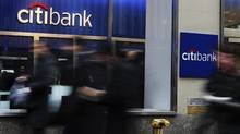 People walk by a Citibank branch in New York January 17, 2012. (SHANNON STAPLETON/REUTERS)