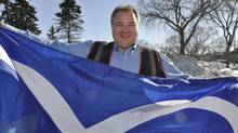 Manitoba Metis Federation president David Chartrand with the Metis Infinity Flag, Oct. 2, 2011. (Robert Tinker For The Globe and Mail)