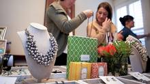 Guests examine jewellery for sale during an in-house jewelry party of Stella and Dot merchandise hosted at Marina Pyo's house. (Della Rollins/The Globe and Mail)