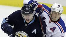 Pittsburgh Penguins' Evgeni Malkin (71) battles with New York Rangers' Marc Staal (18) during the first period of an NHL hockey game in Pittsburgh Friday, Jan. 6, 2012. (AP Photo/Gene J. Puskar) (Gene J. Puskar/AP)