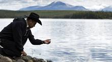 A member of the Xeni Gwet'in First Nation stands at the edge of Fish Lake in B.C. on Sept. 10, 2010. (JOHN LEHMANN/John Lehmann/The Globe and Mail)