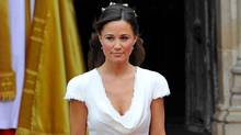Pippa Middleton, the sister of Kate Middleton, walks to escort Kate at Westminster Abbey before her sister's marriage to Britain's Prince William in central London April 29, 2011. (Toby Melville/Reuters)