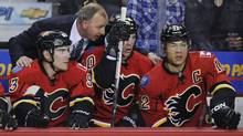 The Calgary Flames' Mike Cammalleri , left, Alex Tanguay and Jarome Iginla listen to head coach Brent Sutter's instructions during a game against the Dallas Stars in Calgary, March 26, 2012. (Todd Korol/Reuters/Todd Korol/Reuters)
