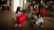 People shop at The Grove mall in Los Angeles on November 26, 2013. (LUCY NICHOLSON/REUTERS)