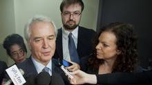 Lawyer Michael Cohen, left, lawyer Rob DeGregory, centre, and NHLPA director of operarions Alex Dagg speak to reporters as they arrive at the Quebec Labour Relations Board in Montreal, Friday, September 14, 2012. (CP)