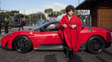 Goodwill Ambassador Gina Lollobrigida arrives at the FAO headquarters in a Ferrari during the World Food Day in Rome on Oct. 17, 2011. The sports car was donated by the auto company and willl be auctioned off to finance FAO projects in Africa. (ALESSANDRA BENEDETTI/ALESSANDRA BENEDETT/AFP/GETTY IMAGES/FAO)