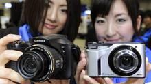 High-speed digital cameras made by Casio Computer (YOSHIKAZU TSUNO/Yoshikazu Tsuno/AFP/Getty Images)