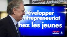 Quebec Premier Jean Charest arrives at a news conference to present his party's theme of the day on Wednesday, August 15, 2012 in Sherbrooke, Que. (Paul Chiasson/THE CANADIAN PRESS)