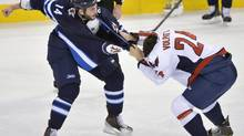 Winnipeg Jets' Anthony Peluso (L) fights Washington Capitals' Aaron Volpatti during the first period of their NHL game in Winnipeg March 2, 2013. (FRED GREENSLADE/REUTERS)