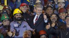 Prime Minister Stephen Harper with workers at the Seaspan shipyards in North Vancouver. (ANDY CLARK/ANDY CLARK/REUTERS)