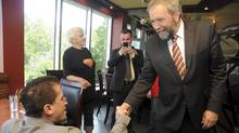 Federal NDP Leader Thomas Mulcair greets supporters in Sudbury on July 31, 2013.