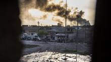 A convoy from the Iraqi Special Forces 2nd division moves into position during fighting in the eastern Samah area of Mosul on Nov. 11, 2016. (ODD ANDERSEN/AFP/Getty Images)