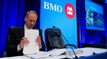 Bank of Montreal president and CEO Bill Downe prepares his notes before addressing shareholders at the company's annual general meeting in Vancouver. (Darryl Dyck/The Canadian Press)