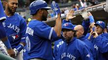 Toronto Blue Jays Edwin Encarnacion (C) celebrates at the dug-out after scoring on a double by J.P. Arencibia against the Detroit Tigers during the seventh inning of their American League baseball game in Detroit, Michigan April 10, 2013. (REBECCA COOK/REUTERS)