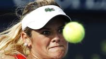 Aleksandra Wozniak of Canada plays a shot against Alexandra Cadantu of Romania during their women's singles match at the U.S. Open tennis tournament in New York August 27, 2012. (EDUARDO MUNOZ/REUTERS)
