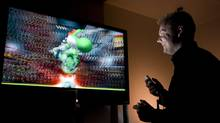 Indie game designer Douglas Tronsgard from Next Level Games plays one of his companies games at his office in Vancouver January 18, 2008. (JOHN LEHMANN/The Globe and Mail)