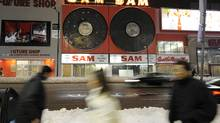 The spinning records above Sam The Record Man on Yonge Street in Toronto went dark after the iconic store shut down. Today, they have been torn down. (Tibor Kolley)