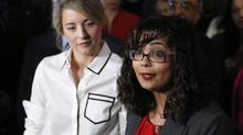 Liberal MP Iqra Khalid makes an announcement about an anti-Islamophobia motion on Parliament Hill while Minister of Canadian Heritage Melanie Joly looks on in Ottawa on Wednesday, February 15, 2017. (PATRICK DOYLE/THE CANADIAN PRESS)
