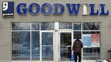 A shopper stands by the locked front doors of the Goodwill store at 60 Overlea Blvd., Jan 18 2016. (Fred Lum/The Globe and Mail)