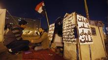 Protesters opposing Egyptian President Mohamed Morsi speak in front of their tents at Tahrir Square during clashes with riot police in Cairo January 31, 2013. (AMR ABDALLAH DALSH/REUTERS)