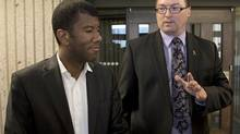 Trevor Zinck, accompanied by his lawyer Lyle Howe, heads from Nova Scotia Supreme Court in Halifax on Monday, June 17, 2013. (Andrew Vaughan/THE CANADIAN PRESS)