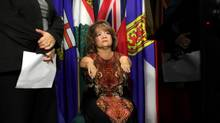 Thalidomide victim Mercedes Benegbi pauses during a news conference on Parliament Hill supporting NDP motion calling for compensation for Thalidomide survivors. (Dave Chan For the Globe and Mail)