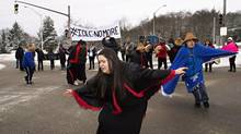 The Spirit of Kitlope dancers perform in an intersection in Kitimat, B.C., as other members of the Haisla First Nation block traffic as part of a rally in support of the Idle No More movement on Dec. 30. (ROBIN ROWLAND/THE CANADIAN PRESS)