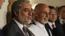 Afghanistan's presidential candidate Abdullah Abdullah (L) addresses a news conference with rival Ashraf Ghani (R) at this side as they announced a deal for the auditing of all Afghan election votes at the United Nations Compound in Kabul, late July 12, 2014. (JIM BOURG/REUTERS)