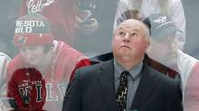 In this Oct. 8, 2016, photo, new Minnesota Wild head coach Bruce Boudreau checks the scoreboard in the first period of an NHL preseason hockey game in St. Paul, Minn. Boudreau will be behind the bench for the Minnesota Wild home opener on Saturday night, 40 years after he played in an arena on the same corner of downtown St. Paul for a WHA team called the Fighting Saints. (Jim Mone/AP)