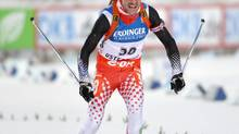 Jean-Philippe Le Guellec, of Shannon, Que., became the first Canadian male biathlete to win a World Cup gold medal, at a meet last December. (ANDERS WIKLUND/AP)