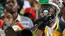 A South African man plays the vuvuzela, large coloured plastic trumpet, in the stands before the Fifa Confederations Cup football match Spain vs South Africa on June 20, 2009 at the Free State Stadium in Bloemfontein. AFP PHOTO / ROBERTO SCHMIDT