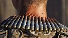 A U.S. Marine machine gunner wears a bandolier of ammunition around his neck at his base in Talibjan after a patrol in southern Afghanistan's Helmand province on Nov. 9, 2010. (FINBARR O'REILLY/REUTERS)