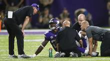 In this Sept. 18, 2016, file photo, Minnesota Vikings running back Adrian Peterson (28) talks with head coach Mike Zimmer, left, after getting injured during the second half of an NFL football game against the Green Bay Packers, in Minneapolis. (Jim Mone/AP)