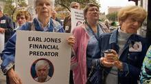 Some of the victims of financial advisor Earl Jones call for harsher sentences for white collar crimes during a demonstration in front of the courthouse in Montreal, Quebec. Jones is charged with defrauding his clients of over $50 million. (Ryan Remiorz/The Canadian Press)