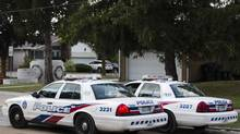 Police cars are parked in the neighbourhood where Toronto police Constable James Forcillo lives in Toronto, August 19, 2013. Constable Forcillo is expected to surrender himself into custody Tuesday to the Special Investigations Unit, a civilian agency that acts as a police watchdog, after being charged with second-degree murder in the shooting death of eighteen year old Sammy Yatim, during an altercation on a streetcar used for public transit in July. (MARK BLINCH/REUTERS)